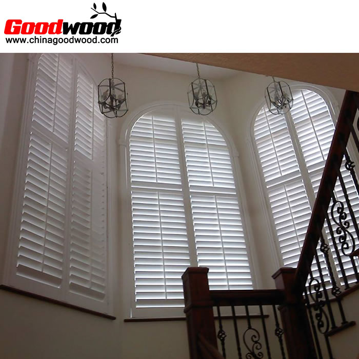 interior plantation shutters arched windows near stairs