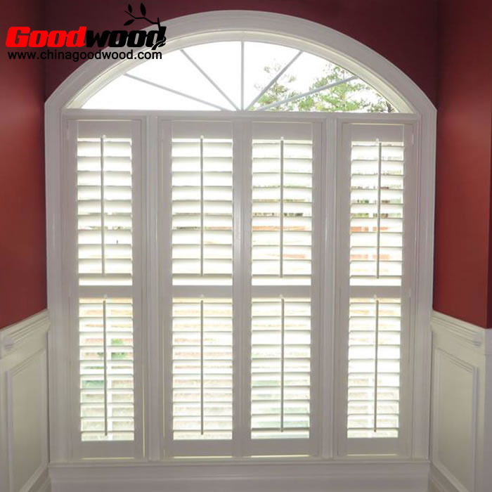 arched window shutters on square windows