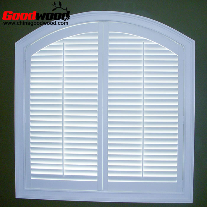 arched wood plantation shutters swing doors interior