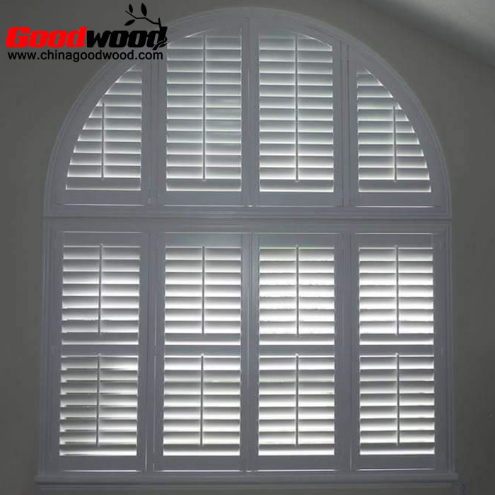 arched interior shutters on square windows