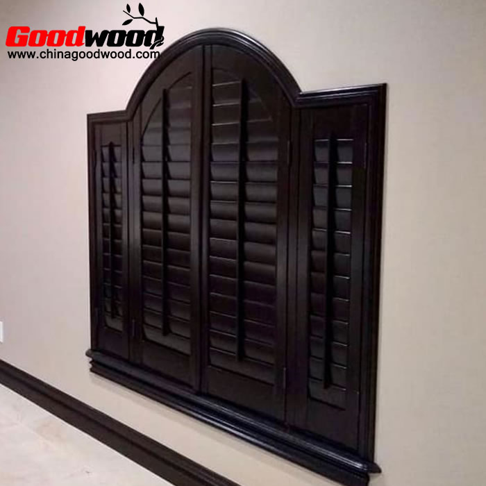 interior wooden plantation shutters arched windows