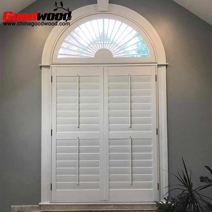 arched sunburst shutters on square windows