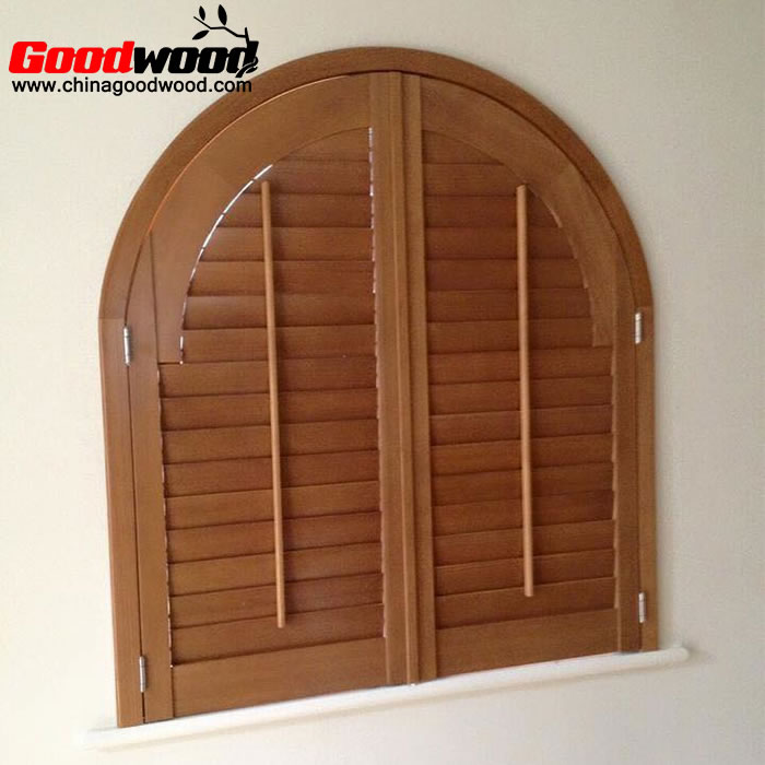 arched wooden shutters